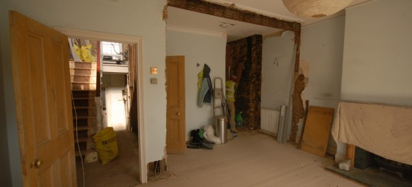 The living room where the arch and the chimney breast have been removed