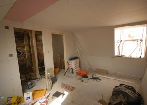 The loft room has been plaster boarded (the en-suite is on the left)