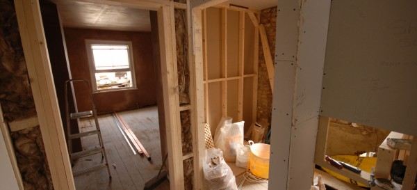 Plaster boarding and insulating the internal walls