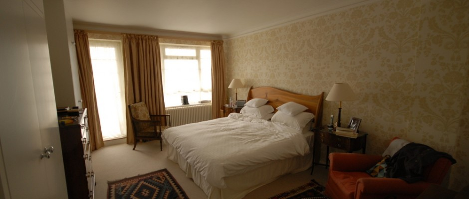 In the master bedroom - bespoke wardrobes were built and the walls were wallpapered.