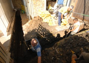 The team digging out the foundations by hand