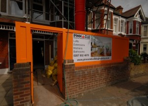 The custom orange hoarding with banner
