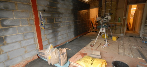 The floor being screeded over the 'wet' underfloor heating
