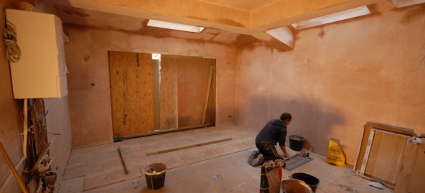 The floor tiles being laid - plastering has been done
