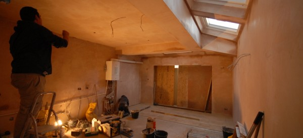 Plaster is drying, floor tiles being laid and wiring being done
