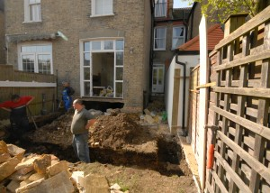Day one - the guys are digging the foundation trenches by hand