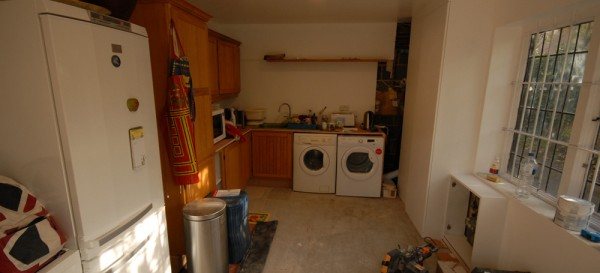 We used some of the old kitchen units and fitted them inside the garage to create a utility room