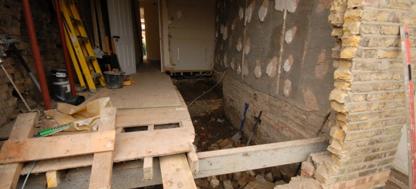 Lowering the floor level - note temporary beam in place which will help support the house while box frame is inserted