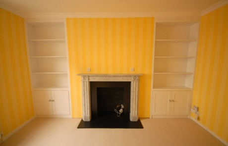 bespoke shelves and cupboards and Chesneys mantlepiece