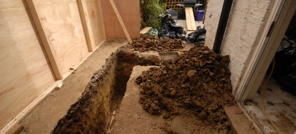The foundation trench dug by hand