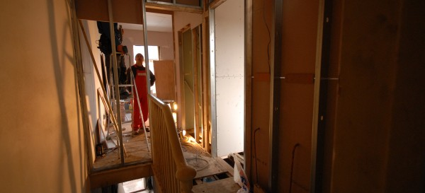 Fixing the new partitioning upstairs leading into the master bedroom and the two bathrooms