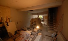 Plaster boarding the living room and kitchen open area downstairs