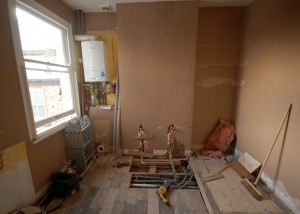The double sink will go in the centre of the chimney breast