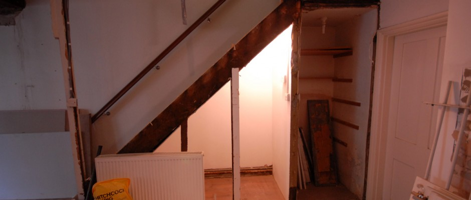 The stairs leading down into this semi basement have been opened up - we will build bespoke cupboards underneath the stairs for storage for this house in Shepherds Bush
