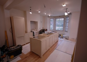 George fits the kitchen in Westcroft Square in Shepherds Bush (Note the wooden flooring has been fitted)