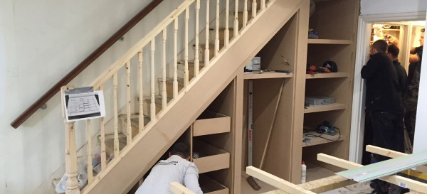 Nick builds the storage cupboards and shelving under the stairs