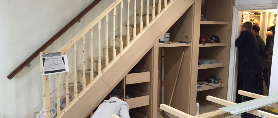 Drawers and shelving under the stairs