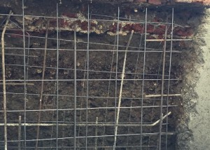 re-enforcing the front wall below the pavement
