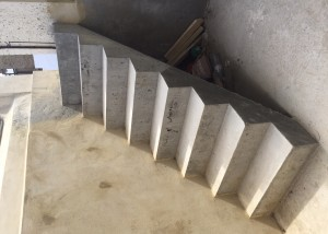 The finished cement wall and steps