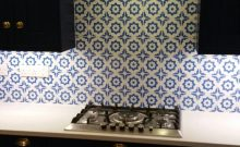 The finished tiles behind the hob