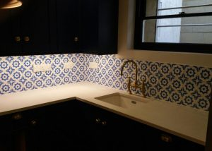 Splashback tiling behind the sink (under cabinet lighting works well in this situation)