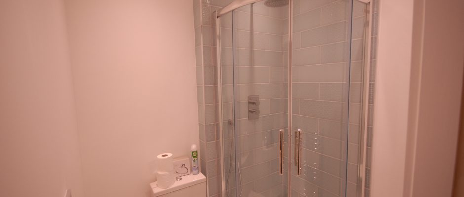 New ensuite shower room with loo and basin in this Colliers Wood house