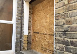 This used to be a door - we are putting a window here. (Note, new concrete sill and brickwork).