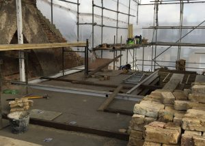 We are using reclaimed bricks to build up the party wall at the rear (note the newly fitted ridge beam)