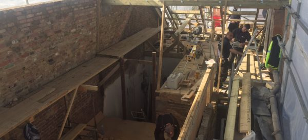 The team are busy building the wooden roof structure on this loft conversion in Fulham. Note the party wall on the left has been built up.