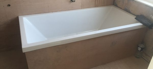 The old bath has been put back in place - we are now ready to fit the shower tray and to retile this bathroom in Fulham