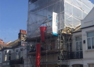 The scaffold and tin roof structure over this Fulham loft conversion project