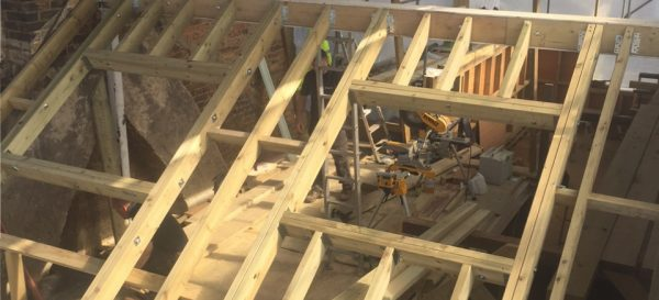The front roof framework is being built