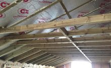 The insulation is being fitted inside the roof on this Fulham loft conversion