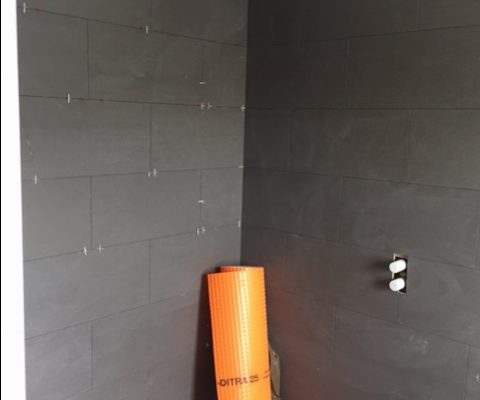 Tiling in the top bathroom on the Kings Road